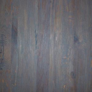 Dessus de table de bois couvert d'huile grise